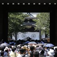People visit Yasukuni Shrine in Tokyo on Friday. U.S. military leaders in Japan reportedly told troops to avoid the divisive shrine before President Barack Obama's April visit. | BLOOMBERG