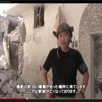 A screenshot from a video uploaded to YouTube shows Haruna Yukawa in Syria in May 2014, standing in front of a recently bombed home. | YOUTUBE