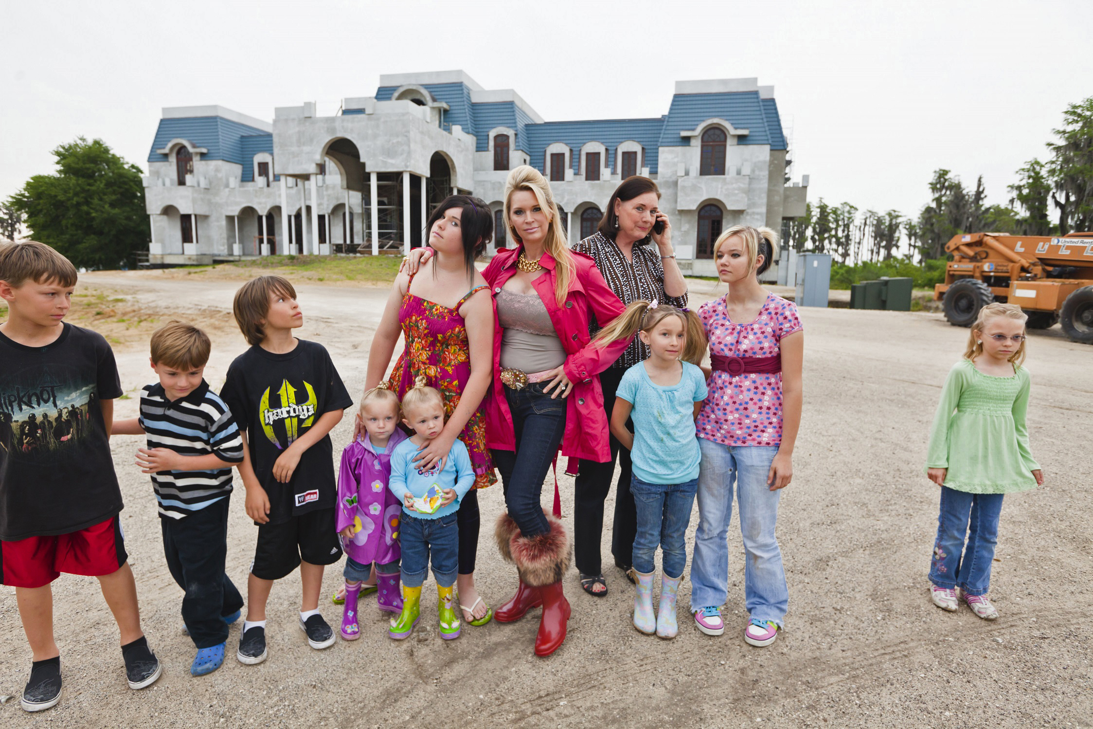 Larger Than Life Jackie Siegel Center Surrounded By Her Eight Children In