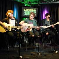 A little longer: Michael Clifford, Luke Hemmings, Calum Hood and Ashton Irwin of 5 Seconds of Summer visit the Q102 Performance Theater in Philadelphia in April. | AP