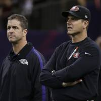 Family affair: Baltimore Ravens coach John Harbaugh (left) and younger brother Jim, coach of the San Francisco 49ers, will face off in their preseason opener on Thursday. | AP
