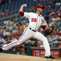 Fine season continues: Washington starter Doug Fister throws a pitch against the Mets in the third inning on Wednesday. | AP