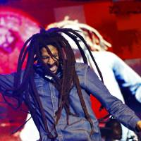 One love: Julian Marley, son of iconic reggae artist Bob Marley, performs at the National Stadium in Kingston on Feb. 7 at an event celebrating his late father.   REUTERS