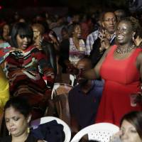One love: Members of an audience at the Jamaican Jazz and Blues festival in Trelawny, Jamaica, on Jan. 30.   REUTERS