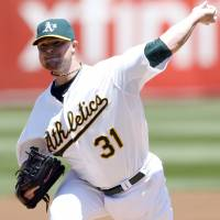 Fresh start: Oakland's Jon Lester fires a pitch against Kansas City in the first inning on Saturday in his first game with the A's. | REUTERS/USA TODAY SPORTS