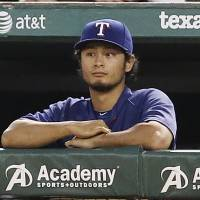 Sidelined: Texas Rangers ace Yu Darvish has been placed on the disabled list with inflammation in his right elbow. | AP