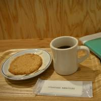 Take a break: Reading over coffee at Standard Bookstore. | J.J. O'DONOGHUE