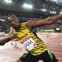 Patented pose: Usain Bolt celebrates following Jamaica's victory in the 4x100-meter relay at the Commonwealth Games in Glasgow on Saturday. | AFP-JIJI