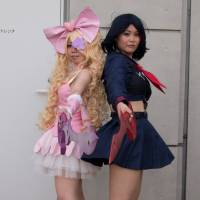 Dangerous women:'Kill La Kill's Ryuko Matsui and Nui Harime call a truce long enough to pose for photographers with their impressive homemade weapons.