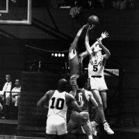 Major contributor: U.S. captain Bill Bradley (5) averaged 10.1 points in nine games at the 1964 Tokyo Olympics as coach Hank Iba's team captured the gold medal. | AP