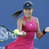 Cruises to win: Ana Ivanovic plays a shot from American Christina McHale in their second-round match at the Western & Southern Open on Wednesday. Ivanovic won 6-4, 6-0. | AP