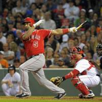 Finding his stroke: Los Angeles' Albert Pujols hits an RBI single against Boston in the third inning on Monday night. | REUTERS/USA TODAY SPORTS