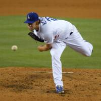 Ace in the hole: Dodgers pitcher Clayton Kershaw delivers during a 2-1 win over the Braves on Thursday in Los Angeles. | AP