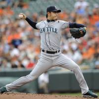 Only takes one: Mariners starter Hisashi Iwakuma pitches against the Orioles on Sunday in Baltimore. Iwakuma allowed one run over 7⅔ innings in a 1-0 loss. | AP