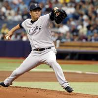 Bringing the heat: Yankees starter Hiroki Kuroda delivers a pitch against the Rays on Sunday in St. Petersburg, Florida. Kuroda lasted into the seventh inning of New York's 4-2 victory over Tampa Bay. | REUTERS/USA TODAY SPORTS