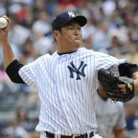 New York special: Yankees pitcher Hiroki Kuroda delivers against the White Sox on Saturday. New York won 5-3. | AP