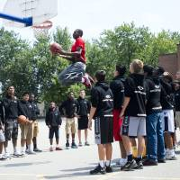 Elite instruction: Andrew Wiggins, the No. 1 pick in the 2014 NBA Draft, shows students at a Toronto high school how to dunk while shooting a commercial on Monday. | AP