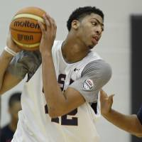 Waiting in the wings: Anthony Davis (left) practices against a coach during a U.S. national team practice on Tuesday in East Rutherford, New Jersey. | AP