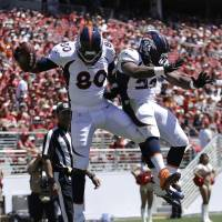In midseason form: Broncos tight end Julius Thomas (80) celebrates with C.J. Anderson after scoring a touchdown against the 49ers during the second quarter on Sunday.   AP