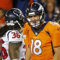 Nice to meet you: Broncos quarterback Peyton Manning and the Texans' D.J. Swearinger exchange words on Saturday. | AP
