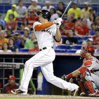 A pair of jacks: Miami's Giancarlo Stanton watches his two-run homer against St. Louis in the first inning on Monday night. | AP