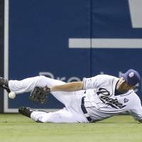 Too late: San Diego's Seth Smith is unable to catch a double by Milwaukee's Khris Davis in the sixth inning on Monday night. | AP