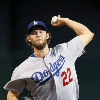 Sweet 16: Los Angeles ace Clayton Kershaw fires a pitch against Arizona in the first inning on Wednesday. | AP