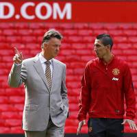 Rebuilding mode: Manchester United's new signing Angel di Maria (right) and manager Louis van Gaal will try to steer the Premier League team in the right direction after its stunning 4-0 loss to League One side MK Dons.   REUTERS