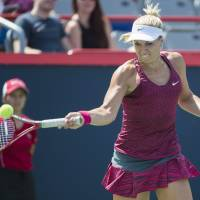 High-speed server: Germany's Sabine Lisicki plays a shot from Italy's Sara Errani during their first-round match at the Rogers Cup on Monday. Lisicki won 6-1, 7-5. | AP