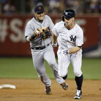 In pursuit: Detroit shortstop Eugenio Suarez chases New York's Brett Gardner during a rundown on Monday night. | AP