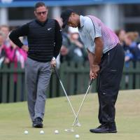 Parting ways: Tiger Woods announced Monday that he has parted ways with swing coach Sean Foley. The pair is seen here at the British Open last month.   AP