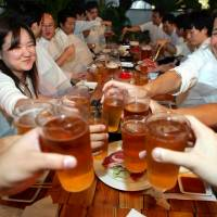 Peer pressure: Staffers are often encouraged to go out for a few drinks after work.   AP