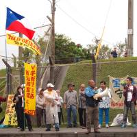Outrage: Demonstrators protest outside Camp Schwab. | JON MITCHELL