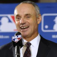 Moving up: Major League Baseball chief operating officer Rob Manfred speaks to reporters on Thursday in Baltimore after being elected commissioner in a vote by team owners. | AP