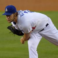 Power and precision: Los Angeles' Clayton Kershaw delivers during the Dodgers' 2-1 win over the Padres on Thursday. | AP