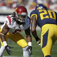 Tall tale: USC cornerback Josh Shaw has admitted lying about saving his nephew from a pool to cover up injuries he suffered to both ankles during the weekend. | AP