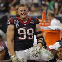 Focused: Houston Texans defensive end J.J. Watt and his teammates will try to bounce back this season after finishing with a 2-14 record last year. | AP