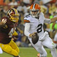 Scrambling: Cleveland QB Johnny Manziel scrambles away from Washington's Will Compton in the second half on Monday night. The Redskins beat the Browns 24-23. | AP