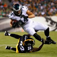 Cold steel: Philadelphia wide receiver Riley Cooper is tackled by Pittsburgh cornerback William Gay on Thursday. | AP