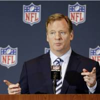 Taking another look: NFL commissioner Roger Goodell, seen in a file photo from March, revealed the NFL's new, harsher penalties for domestic violence on Thursday. | AP