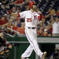Clutch clout: Washington's Adam LaRoche watches his solo homer against Arizona leave the yard in the 11th inning on Monday. | AP