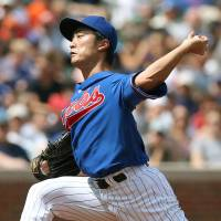 Better late than never: Cubs starter Tsuyoshi Wada delivers a pitch against the Orioles during their game on Sunday in Chicago. The Cubs won 2-1. | KYODO