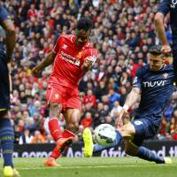 Right down the middle: Liverpool's Raheem Sterling takes a shot during Sunday's 2-1 win over Southampton. | REUTERS