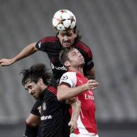 Meeting of the minds: Arsenal's Oliver Giroud (right) competes for the ball with Besiktas' Ersan Gulum (top) and Veli Kavlak during the first leg of their Champions League qualifier.   REUTERS