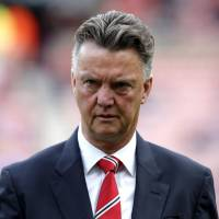 Still waiting: Manchester United manager Louis van Gaal leaves the pitch after Sunday's 1-1 draw with Sunderland. | REUTERS