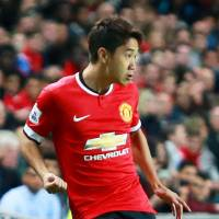 Stuck in a rut: Shinji Kagawa competes during Manchester United's 4-0 loss to MK Dons on Tuesday. | KYODO