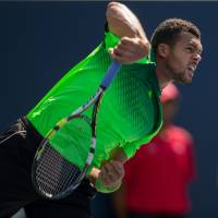 Go out with a bang: Jo-Wilfried Tsonga follows through after hitting a shot during the Rogers Cup final on Sunday. | AFP-JIJI