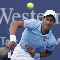 Bounced again: Novak Djokovic serves to Spain's Tommy Robredo during their third-round match at the Western & Southern Open on Thursday. Robredo won 7-6 (8-6), 7-5. | AP