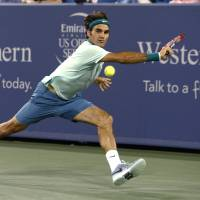 Backhand on the run: Roger Federer plays a shot from Canada's Milos Raonic in their semifinal match at the Western & Southern Open on Saturday. Federer won 6-2, 6-3. | AP