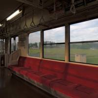 Lazy afternoon: Sunlight cuts across an empty car on a local train on the Tohoku Main Line.   DAVEY YOUNG